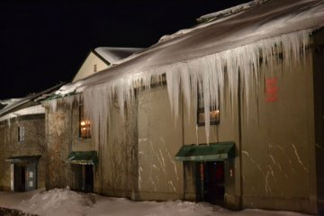 Snow-dripping alluring warehouse
