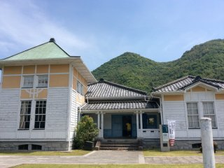 Ryujoukan - The building seamlessly combines Japanese and Western styles with light blue window frames, green doors and roof and Japanese roof tiles.