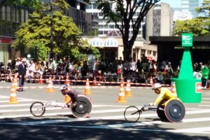 The leading athletes of the wheel chair division speed down the streets in a blur.
