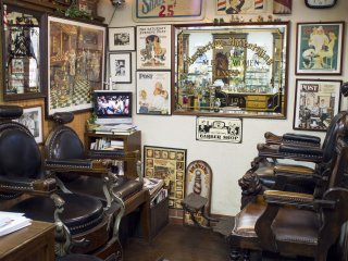 The front area of the barbershop, where most of the old barber posters reside.