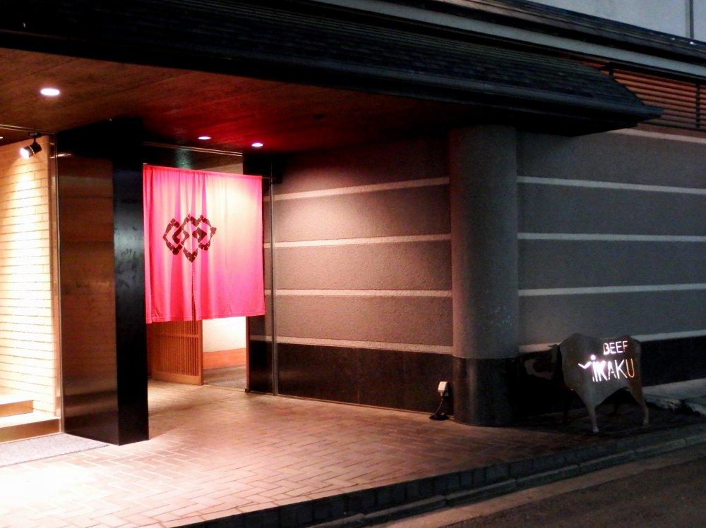 Lit-up entrance of 'Beef MIKAKU'