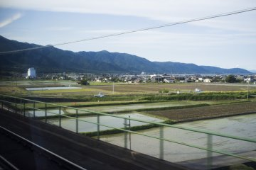 <p>The picturesque mountains looming over quiet towns, with Lake Biwa in sight.</p>
