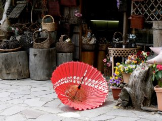 The spring breeze was trying to steal an umbrella from the gift shop.