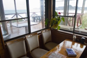 <p>The sea is visible from inside the cafe</p>