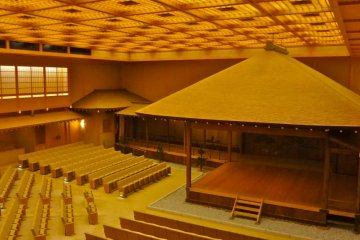 The stage of Noh is in the right corner of the theater and a long corridor connects the stage with the left wing. The audience seats are set in three directions facing the stage.