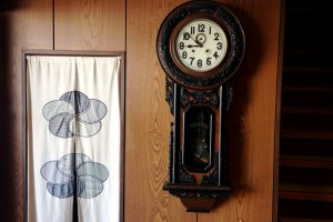 An old clock at the entrance to the ryokan
