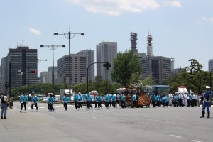 The parade heads towards Tokyo Station