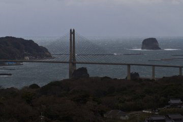 <p>Stormy view of the big bridge to Kabe Island, with Taka Island on the right</p>