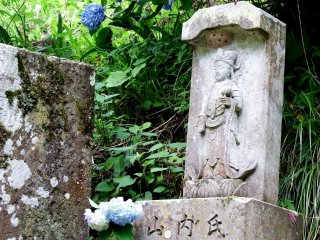The third statue, and wild hydrangeas along the road