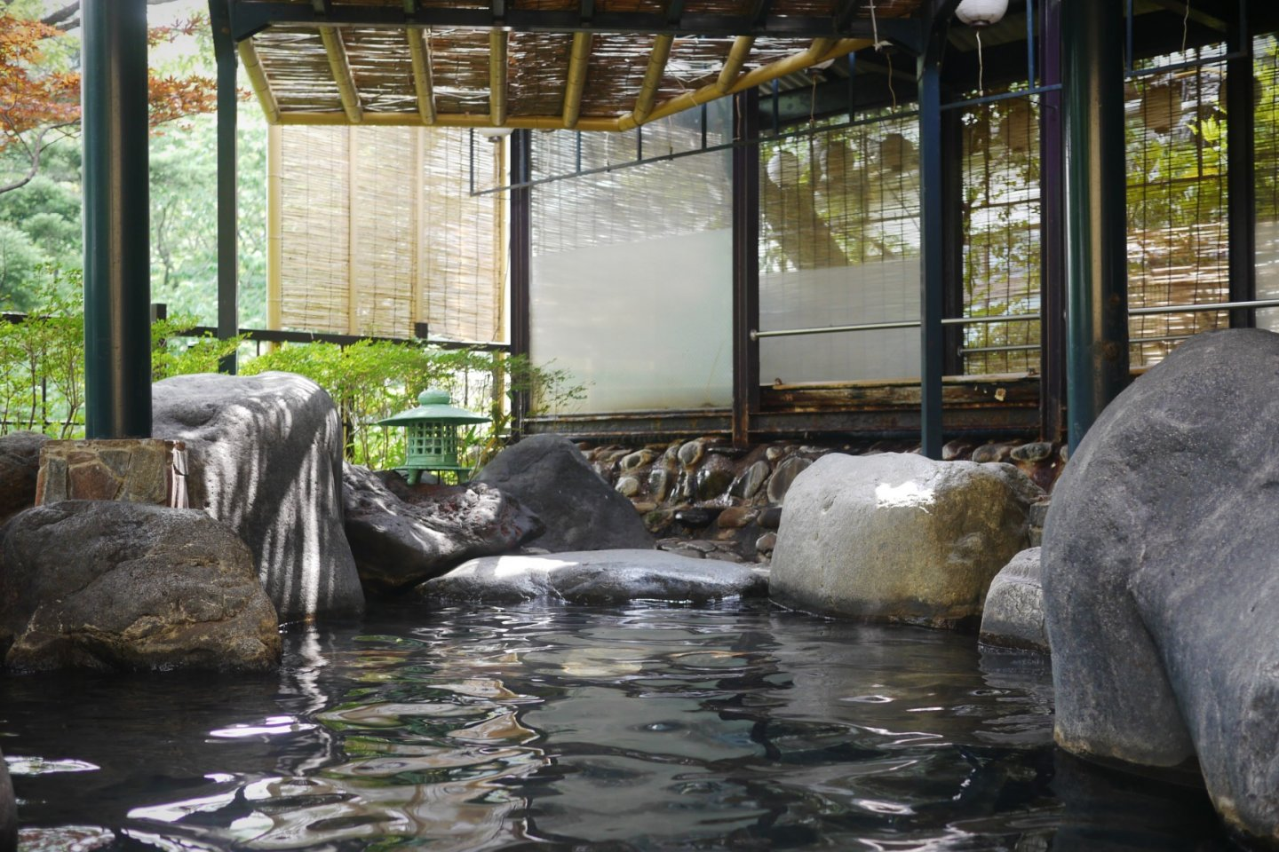 Outdoor onsen with a view of the river