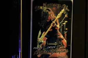 """The poster of the famous Japanese thrash metal band """"United"""" at the entrance to GODZ Bar"""