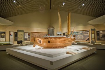 <p>The two 16th century ships, with the Japanese one in the foreground; the Korean Turtle Ship&#39;s sails are seen behind it</p>