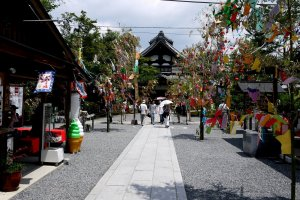 The path to the temple looks very festive flanked by the decorated bamboo branches