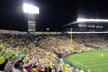 Hanshin Tigers prepare balloons for the seventh-inning stretch
