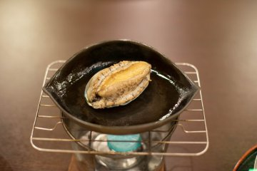 Fresh abalone cooked at the table