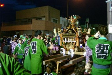 <p>Hanyu Natsu&nbsp;matsuri - local men wearing happi&nbsp;coats and shorts carry portable shrines through the streets while chanting together</p>