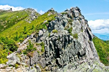 <p>One of several rocky peaks along the way to the summit of Mount Kinpu</p>
