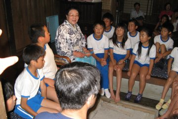 <p>The tales of Tono are passed down to the children</p>