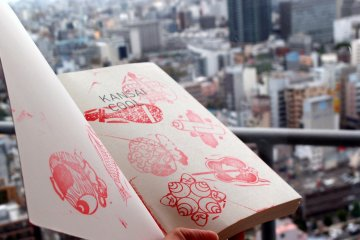 Kansai is cool indeed! Stamping the symbols of good fortune on the only available paper that I have.