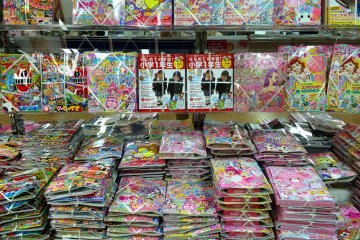 <p>Visit a Japanese bookstore! Some anime, manga, &amp; fashion magazines will come packaged with a free gift.</p>