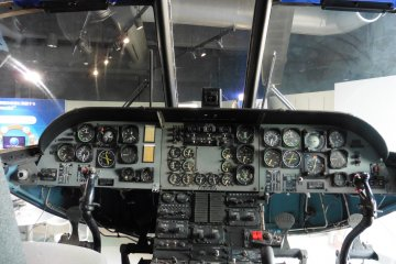 <p>Piloting (?) a helicopter!</p>