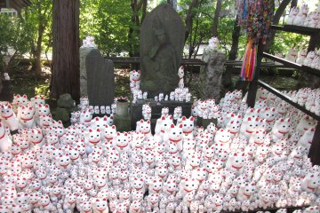 <p>A shrine in the Gotoku-ji&#39;s grounds dedicated to the maneki neko. The popular cat symbolizes bringing wealth and prosperity to its owner, which is why they are commonly seen at the entrance of Japanese shops, restaurants and homes.</p>