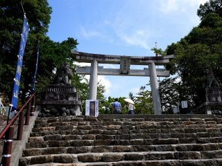 Up the steps and through the stone torii