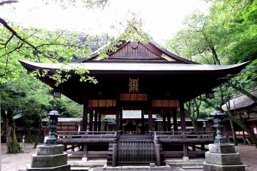 <p>This building probably is a Noh stage, or some platform where Shinto rituals are performed</p>