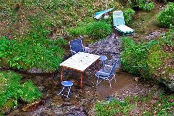 <p>Teatime anytime! Quite what these tables and chairs are doing in the middle of this river is anyone&rsquo;s guess; teatime in the river perhaps. I wonder if this is a trend which will take off?</p>