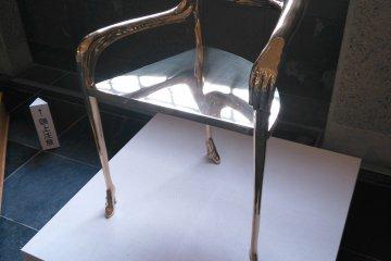 <p>The balance and precision of a three-legged chair</p>