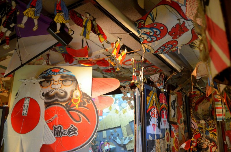 <p>Kites cover almost every inch of the space.</p>