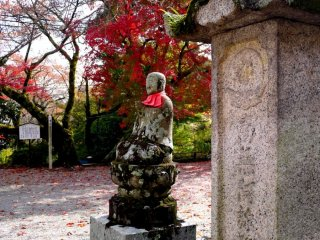 The color of the maple echoes the statue's apron