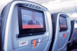 The flight's instructional safety video is brought to all passengers by the seat back entertainment system