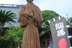 A statue of Ryoma Sakamoto in front of the Okichi Memorial Hall