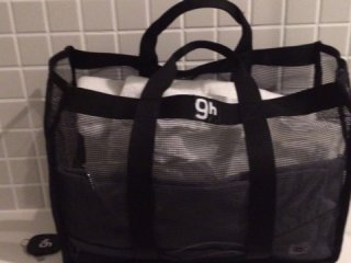 Bag contains pajamas, a toothbrush, toothpaste, small and big towels, and sandals