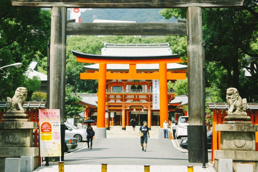 The entrance from the main street, with a wooden torii gate, and another behind