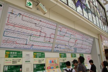 <p>Checking the map of the vast JR East train system</p>