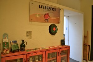 The third-floor entrance to Leibspeise displays a cupboard of beer mugs