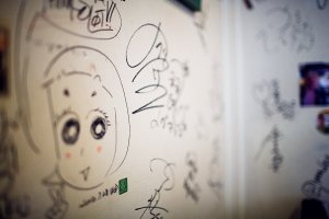 The walls of the cafe are covered with the signatures and scribbles of famous actors, performers and comedians