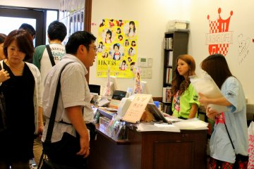 <p>Several people lined up to purchase items from the store, while others just wanted to ask questions, or perhaps, for the cashier&#39;s autograph, as she looks like an AKB48 member as well</p>
