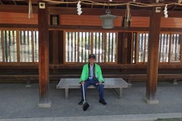 <p>One of the shrine volunteers happily poses for the camera</p>