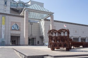 'Flatbed Trailer' (2007) is one of the most impressive monuments at the Yokohama Triennale 2014 and stands in front of the entrance to the Yokohama Art Museum.