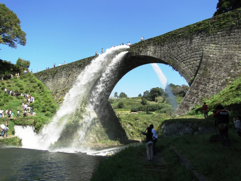 <p>Water roars out of the Tsujunkyo&nbsp;aqueduct in rural Kumamoto</p>