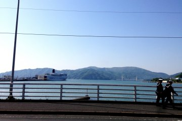 <p>The port city of Maizuru is framed by mountains.</p>