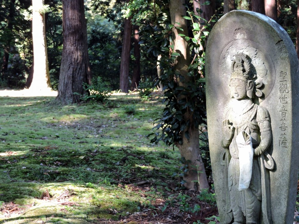 Thirty-three statues of Kannon Bosatsu (Goddess of Mercy) like this are spread out around a silent woods