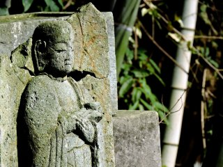 One of the small jizo statues sitting in its final resting place
