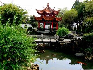 A bridge spans the pond near the pagoda
