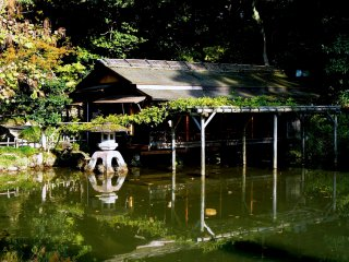 A teahouse built on the edge of a pond. The striking stone lantern has been moved since these photos were taken.