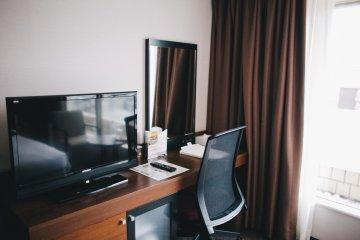 <p>Desk area and television</p>