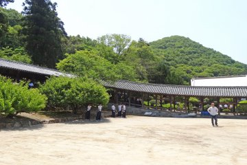 <p>The 400 meter covered corridor with some teens practicing their Kyudo</p>